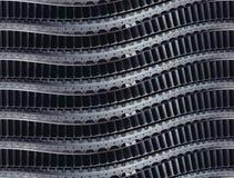 Предпосылка горизонтальной сюрреалистической линейной технологии изготовления лезвий турбины промышленная Изогнутые крыла турбины Стоковая Фотография
