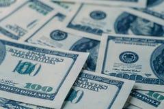Предпосылка дег, американец 100 счетов доллара Стоковое фото RF