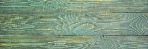 Предпосылка деревянной текстуры всходит на борт с обмылками салатовой краски горизонтально narrow стоковые изображения