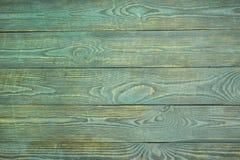 Предпосылка деревянной текстуры всходит на борт с обмылками салатовой краски горизонтально стоковая фотография