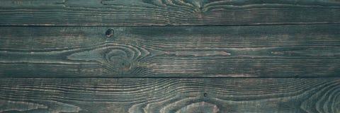 Предпосылка деревянной текстуры всходит на борт с обмылками темной ой-зелен краски горизонтально narrow стоковое изображение