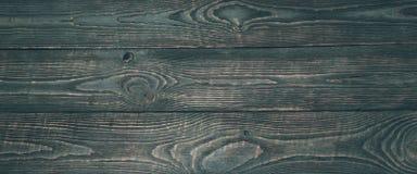Предпосылка деревянной текстуры всходит на борт с обмылками темной краски narrow стоковые изображения