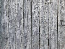 Предпосылка доск доск деревянных с затрапезной краской старые серые доски стоят в ряд Стоковые Фотографии RF