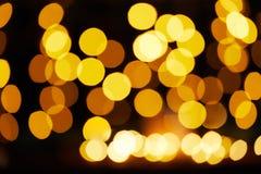 Предпосылка желтых светов рождества defocused стоковая фотография