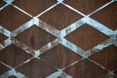 Предпосылка заржаветого винтажного металла с ромбовидным узором и винтажной голубой краской Стоковые Фото