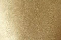 Предпосылка золота или бронзы естественная кожаная Сияющая желтая предпосылка текстуры сусального золота лист установьте текст стоковая фотография