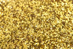 Предпосылка золота сверкнает, помадки, сияющая текстура золота Стоковое Фото