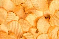 Предпосылка картофельных чипсов Текстура закуски фаст-фуда стоковые изображения