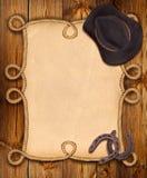 Предпосылка ковбоя с рамкой веревочки и западными одеждами Стоковая Фотография RF