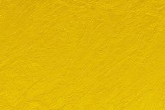 Предпосылка конспекта картины текстуры цвета золота может быть пользой как обложка брошюры заставки бумаги стены или для рождеств Стоковые Фотографии RF
