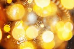 Предпосылка конспекта Christmass в золотых тонах Стоковые Фото