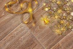 Предпосылка конспекта ` s Нового Года в золотых тонах Стоковые Изображения