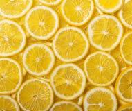 Предпосылка много сочных кусков лимона Стоковое Изображение