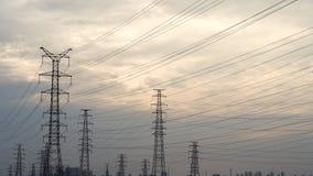 Предпосылка неба башни высоковольтного столба высоковольтная стоковое фото