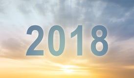 Предпосылка нерезкости захода солнца текста чисел Нового Года 2018 Стоковые Изображения RF
