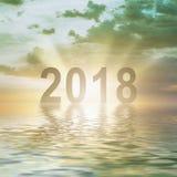 Предпосылка нерезкости захода солнца текста чисел Нового Года 2018 Стоковая Фотография RF