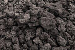 Предпосылка от черной почвы поверхность текстурировала Почва состоит из a Стоковые Фото