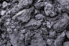 Предпосылка от черной почвы поверхность текстурировала Почва состоит из a Стоковое Изображение