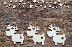 Предпосылка праздников рождества Северный олень и звезда на деревянном столе Стоковое фото RF