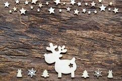 Предпосылка праздников рождества Северный олень и звезда на деревянном backg Стоковые Фотографии RF