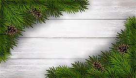 Предпосылка рождества с елью разветвляет на белом деревянном столе Стоковые Изображения RF