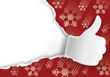 Предпосылка рождества с сорванными бумажными большими пальцами руки вверх Стоковое фото RF