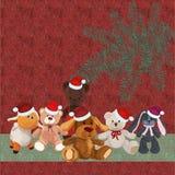 Предпосылка рождества с щенком и другими милыми игрушками плюша Стоковая Фотография