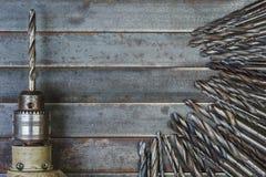 Предпосылка сверла и металла буровых наконечников старая Стоковое Изображение
