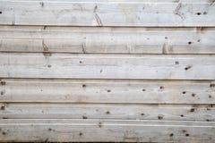 Предпосылка сделана бледных серых запланированных доск с узлами стоковые фото