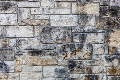 Предпосылка стены с различными размером с каменными слябами стоковые изображения