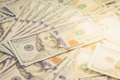 Предпосылка с американцом денег 100 счетов доллара Backg денег Стоковые Фото