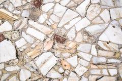 Предпосылка текстуры каменного пола Части мрамора в цементе стоковые изображения