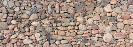 Предпосылка текстуры каменной стены деревенская стена гранита старая Стоковое Фото