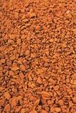 Предпосылка текстуры растворимого кофе Зерна кофе Брайна как повреждает камни пола Зерна растворимого кофе сухие высушенные Стоковые Изображения