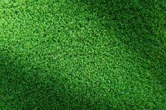 Предпосылка текстуры травы для дизайна поля для гольфа, футбольного поля или концепции спорт Искусственная зеленая трава стоковые фото