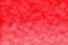 Предпосылка формы сердца Bokeh конспекта красная стоковые изображения rf