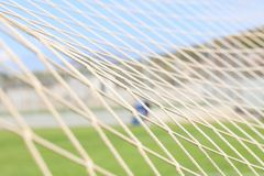 Предпосылка футбола или футбола сетчатая, взгляд от за цели Стоковые Фотографии RF
