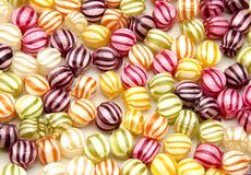 Предпосылка цветастого candiesBackground colorf стоковое изображение rf