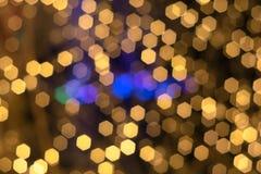 предпосылка шестиугольника света золота Bokeh ฺChristmas красивейший свет стоковая фотография rf