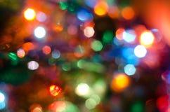 Предпосылка, - яркие пестротканые огни круга Стоковая Фотография