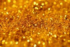 Предпосылка яркого блеска Нового Года и золота рождества Ткань текстуры праздника абстрактная Стоковые Фотографии RF