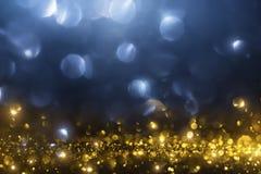 Предпосылка яркого блеска рождества золотая Стоковое фото RF