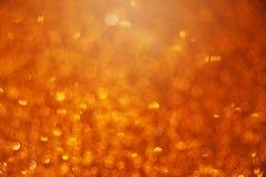 Предпосылка bokeh золота яркая абстрактная Стоковые Фотографии RF
