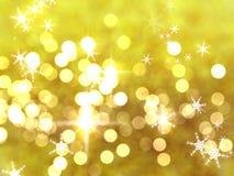 Предпосылка bokeh золота яркого блеска со звездами и снежинками для поздравительных открыток рождества стоковая фотография