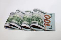 Предпосылка Rolls доллара белая стоковое изображение