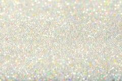 Предпосылка Sparkles светлая, пыль серебра De Focused Sparkling Стоковая Фотография