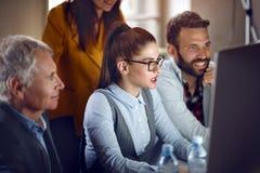 Предприниматели при мужской менеджер работая в студии дизайна Стоковое фото RF