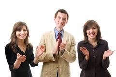 предприниматели clapping усмехаться группы стоковое фото rf