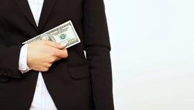 Предприниматель в черноте держа доллар Билл Стоковая Фотография RF