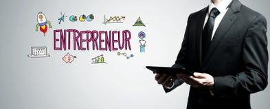 Предприниматель при человек держа планшет стоковое фото rf
